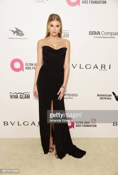 Model Charlotte McKinney arrives at the 26th Annual Elton John AIDS Foundation's Academy Awards Viewing Party on March 4 2018 in West Hollywood...