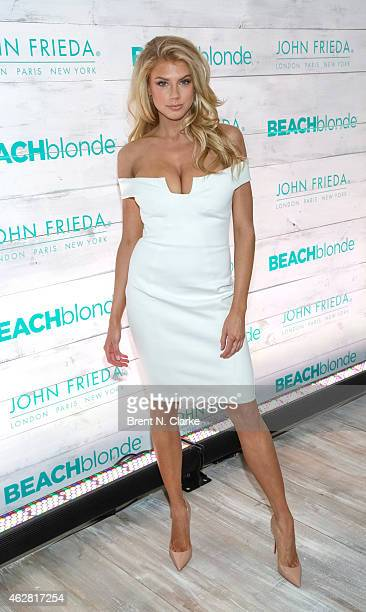 Model Charlotte McKinney arrives for the John Frieda Hair Care Beach Blonde Collection Launch Party at the Garage on February 5 2015 in New York City
