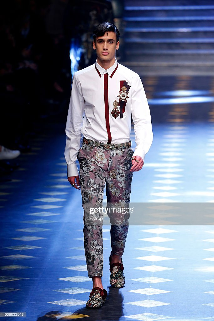 Model Chase Hill walks the runway at the Dolce & Gabbana show during Milan Men's Fashion Week Fall/Winter 2017/18 on January 14, 2017 in Milan, Italy.