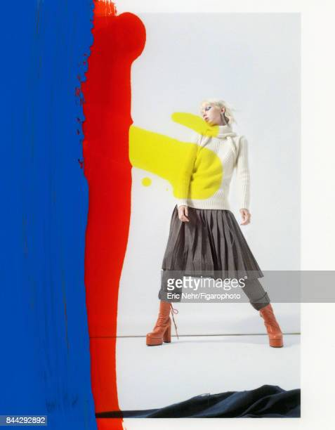 Model Cheyenne Keuben poses at a fashion shoot for Madame Figaro on June 8 2017 in Paris France Sweater skirt and pants earring boots PUBLISHED IMAGE...
