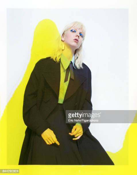 Model Cheyenne Keuben poses at a fashion shoot for Madame Figaro on June 8 2017 in Paris France Trench shirt and skirt ribbon earrings left right...