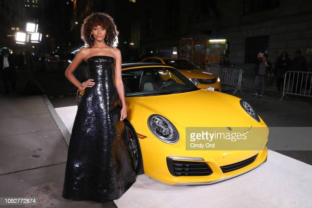 Model Cheyenne Maya Carty poses with a Porsche 911 Speedster at the 2018 Angel Ball hosted by Gabrielle's Angel Foundation at Cipriani Wall Street on...