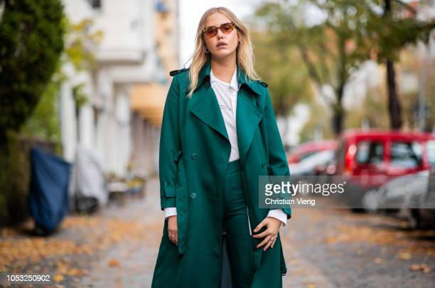 Model Cheyenne Tulsa is seen wearing green pants and trench coat Drykorn white button shirt RIKA tshirt Koenig Souvenir white sneakers Urban...