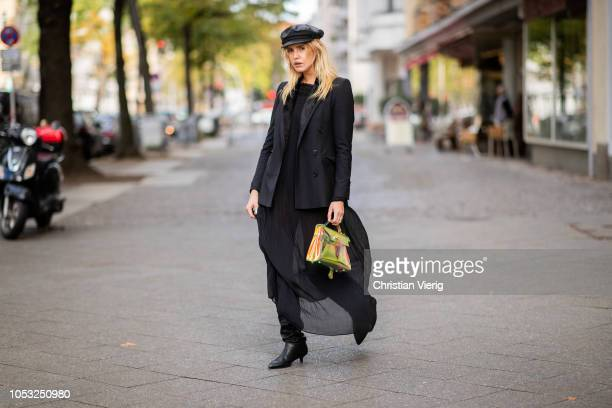 Model Cheyenne Tulsa is seen wearing wearing black leather backer boy hat Brixton 5149 bag black Drykorn blazer black dress Les Eclaires black boots...