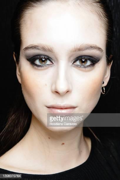 Model Chiara Corridori, make up detail, is seen backstage at the Philipp Plein fashion show on February 22, 2020 in Milan, Italy.