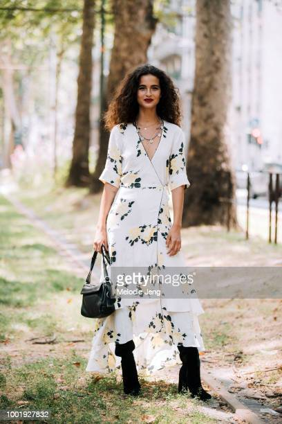 Model Chiara Scelsi after the Dolce Gabbana show in a white yellow floral wrap dress black purse and black boots during Milan Men's Fashion Week...