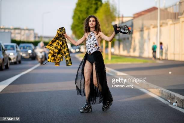 Model Chiara Scelsi wearing net tights body plattform shoes is seen outside Palm Angels during Milan Men's Fashion Week Spring/Summer 2019 on June 17...