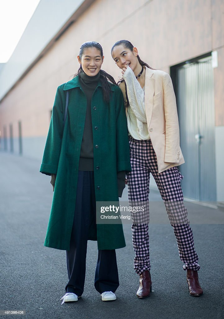 Model Chiharu Okunugi and Mona Matsuoka after Kenzo during the Paris Fashion Week Womenswear Spring/Summer 2016 on October 4, 2015 in Paris, France.