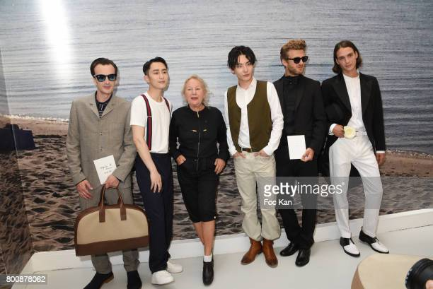 A model Chinese actor Wenzuo Song Agnes B chinese actor Ruichang Wang and models pose during Agnes B Menswear Spring/Summer 2018 show as part of...