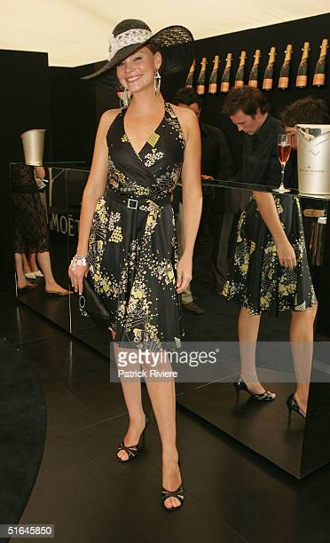 Model Chloe Maxwell poses at the Moet et Chandon marquee at The Melbourne Cup at Flemington Racecourse November 2 2004 in Melbourne Australia