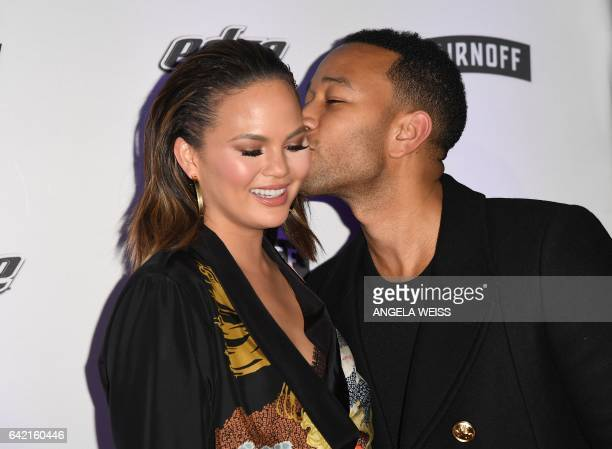 Model Chrissy Teigan and musician John Legend attend the Sports Illustrated Swimsuit 2017 launch event at Center415 Event Space on February 16 2017...