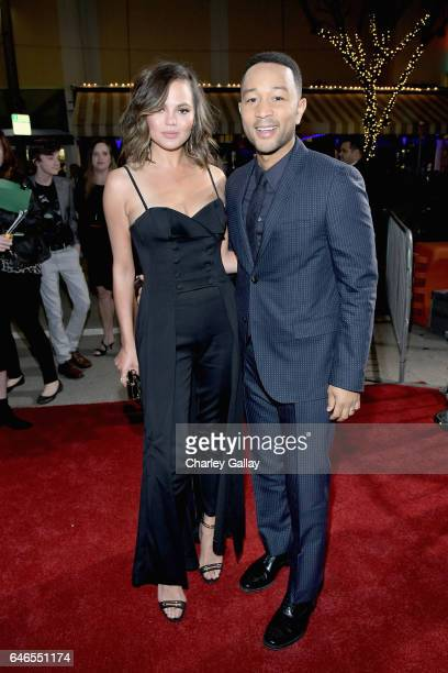 Model Chrissy Teigen and actor/singer/executive producer John Legend attend WGN America's 'Underground' Season Two Premiere Screening at Regency...