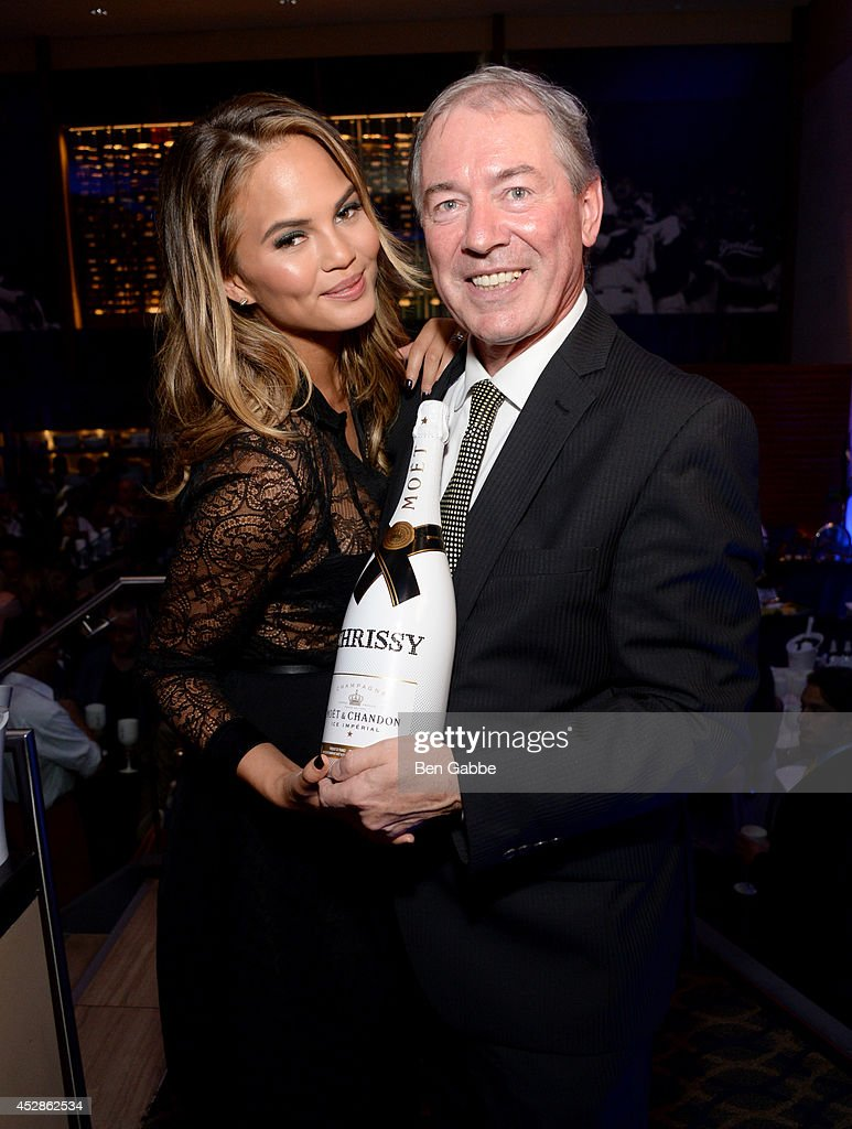 Model Chrissy Teigen (L) and CEO of Moet Hennessy USA Jim Clerkin attend DuJour Magazine and NYY Steak celebrating Chrissy Teigen with FENDI timepieces and Moet Ice on July 28, 2014 in New York City.