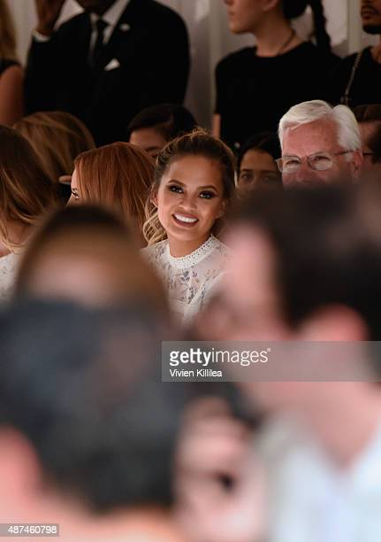 Model Chrissy Teigen and Chief Executive Officer of Kohl's Corporation Kevin Mansell attend the LC Lauren Conrad fashion show during New York Fashion...