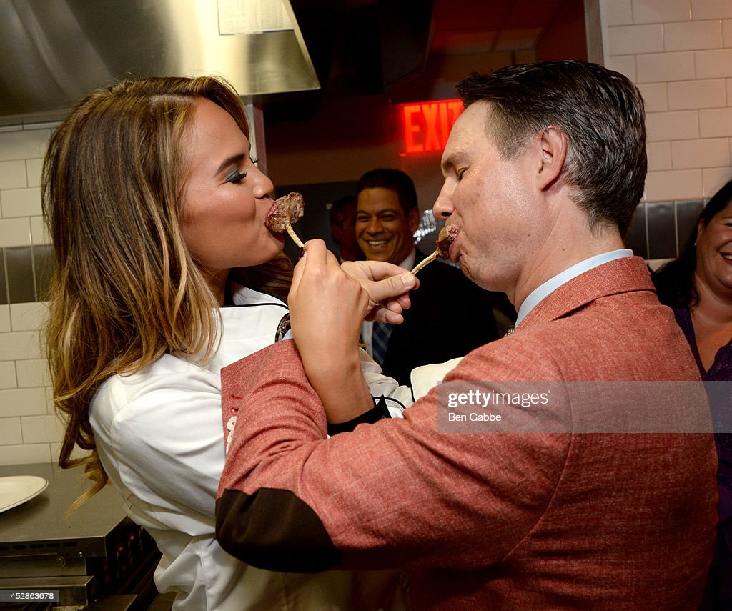 Model Chrissy Teigen (L) and founder of DuJour Media Group Jason Binn attend DuJour Magazine and NYY Steak celebrating Chrissy Teigen with FENDI timepieces and Moet Ice on July 28, 2014 in New York City.