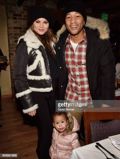 Model Chrissy Teigen and her husband recording artist John Legend pose with their daughter Luna Simone Stephens at the Monster dinner film reception...