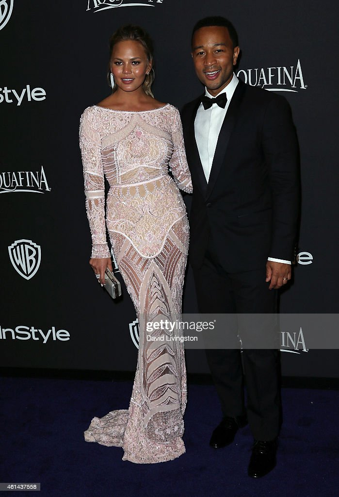 Model Chrissy Teigen (L) and husband musician John Legend attend the 2015 InStyle and Warner Bros. 72nd Annual Golden Globe Awards Post-Party at The Beverly Hilton Hotel on January 11, 2015 in Beverly Hills, California.
