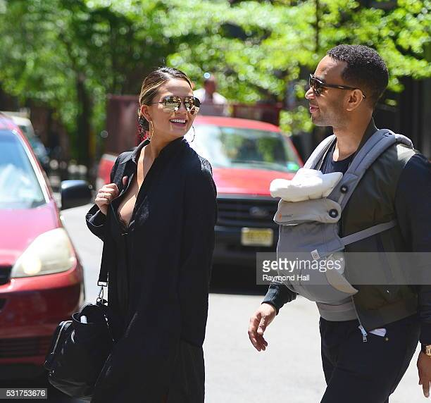 Model Chrissy Teigen and John Legend with their baby Luna Legend are seen walking in Soho on May 16 2016 in New York City