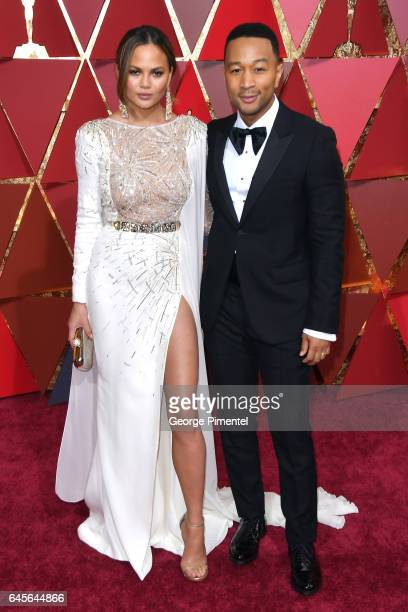 Model Chrissy Teigen and musician John Legend atten the 89th Annual Academy Awards at Hollywood Highland Center on February 26 2017 in Hollywood...
