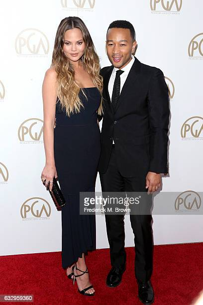 Model Chrissy Teigen and musician John Legend attend the 28th Annual Producers Guild Awards at The Beverly Hilton Hotel on January 28 2017 in Beverly...