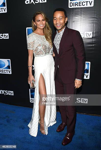 Model Chrissy Teigen and recording artist John Legend attend DirecTV Super Saturday Night hosted by Mark Cuban's AXS TV and Pro Football Hall of...