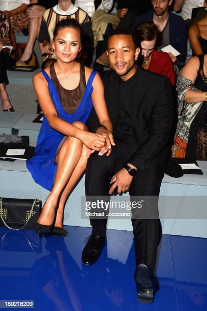 Model Chrissy Teigen and recording artist John Legend attend the Vera Wang fashion show during MercedesBenz Fashion Week Spring 2014 at The Stage at...