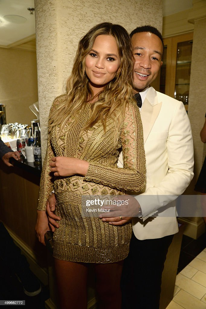 Model Chrissy Teigen and recording artist John Legend pose backstage during 'Sinatra 100: An All-Star GRAMMY Concert' celebrating the late Frank Sinatra's 100th birthday at the Encore Theater at Wynn Las Vegas on December 2, 2015 in Las Vegas, Nevada. The show will air on CBS on December 6.
