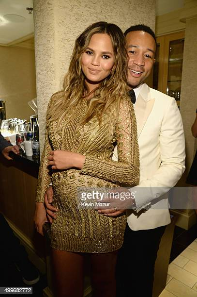 Model Chrissy Teigen and recording artist John Legend pose backstage during 'Sinatra 100 An AllStar GRAMMY Concert' celebrating the late Frank...