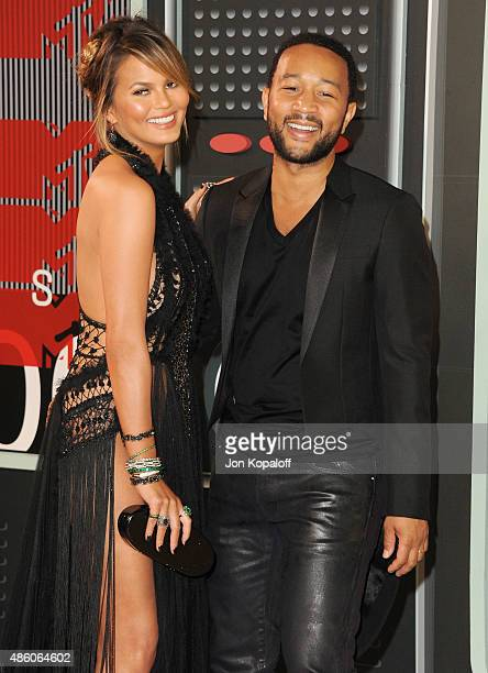 Model Chrissy Teigen and singer John Legend arrive at the 2015 MTV Video Music Awards at Microsoft Theater on August 30 2015 in Los Angeles California