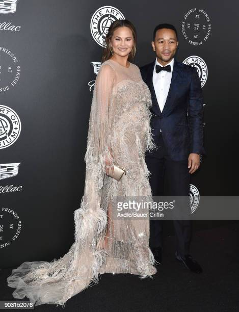 Model Chrissy Teigen and singer John Legend arrive at The Art of Elysium's 11th Annual Celebration Heaven at Barker Hangar on January 6 2018 in Santa...