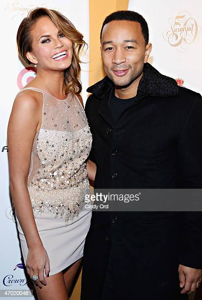 Model Chrissy Teigen and singer John Legend attend as Captain Morgan White Rum and Crown Royal XO raise a glass to the Sports Illustrated Swimsuit 50...