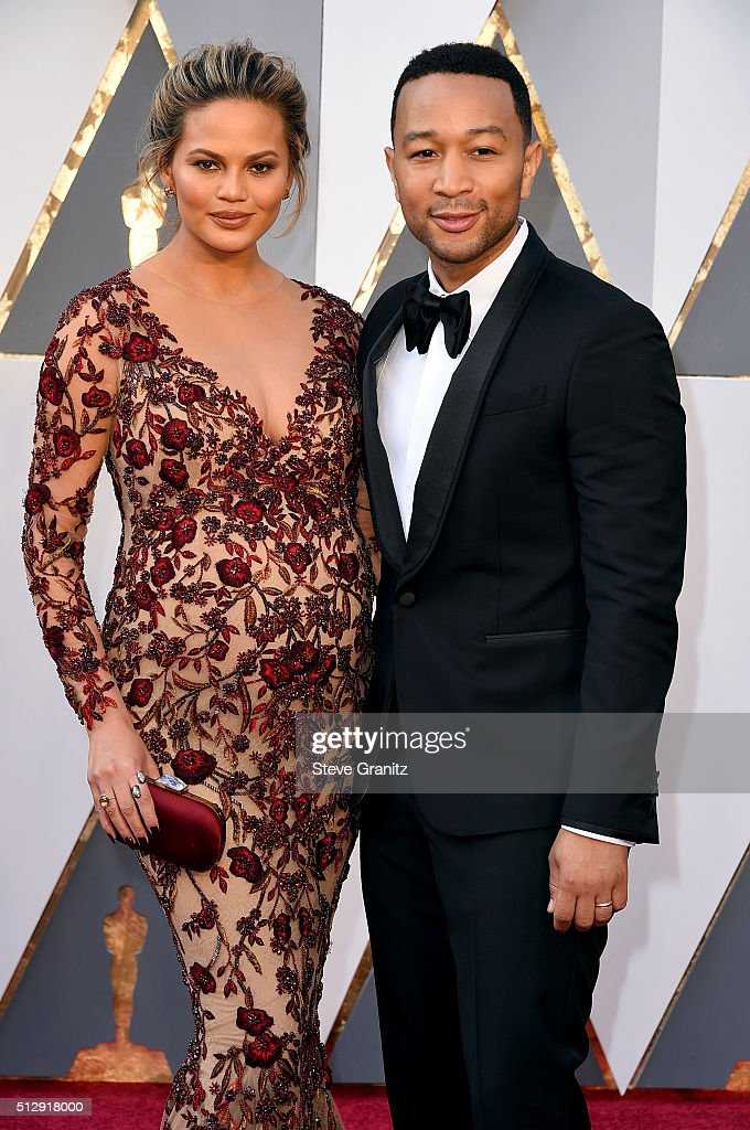 Model Chrissy Teigen (L) and singer John Legend attend the 88th Annual Academy Awards at Hollywood & Highland Center on February 28, 2016 in Hollywood, California.