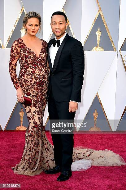 Model Chrissy Teigen and singer John Legend attend the 88th Annual Academy Awards at Hollywood Highland Center on February 28 2016 in Hollywood...