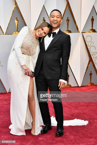 Model Chrissy Teigen and singer John Legend attend the 89th Annual Academy Awards at Hollywood Highland Center on February 26 2017 in Hollywood...
