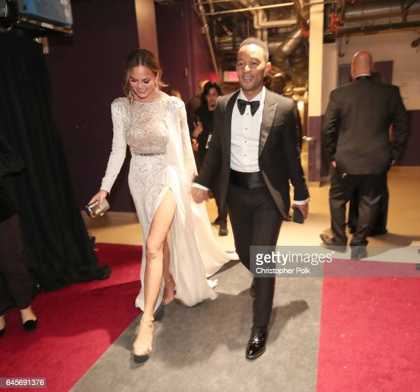 Model Chrissy Teigen and singer John Legend backstage during the 89th Annual Academy Awards at Hollywood Highland Center on February 26 2017 in...