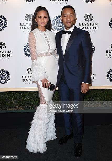 Model Chrissy Teigen and singer-songwriter John Legend arrive at The Art of Elysium celebrating the 10th Anniversary at Red Studios on January 7,...