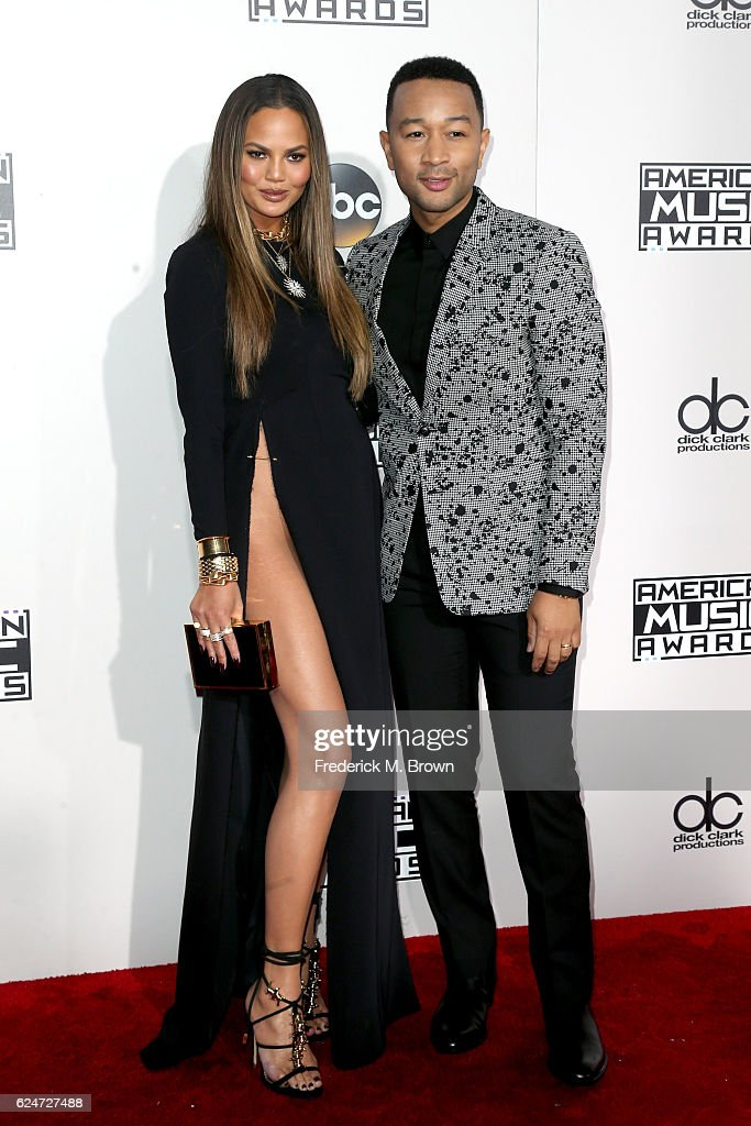 Model Chrissy Teigen (L) and singer-songwriter John Legend attend the 2016 American Music Awards at Microsoft Theater on November 20, 2016 in Los Angeles, California.