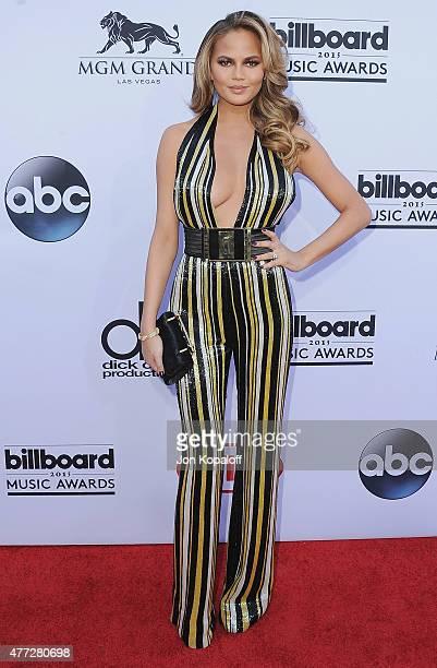 Model Chrissy Teigen arrives at the 2015 Billboard Music Awards at MGM Garden Arena on May 17 2015 in Las Vegas Nevada
