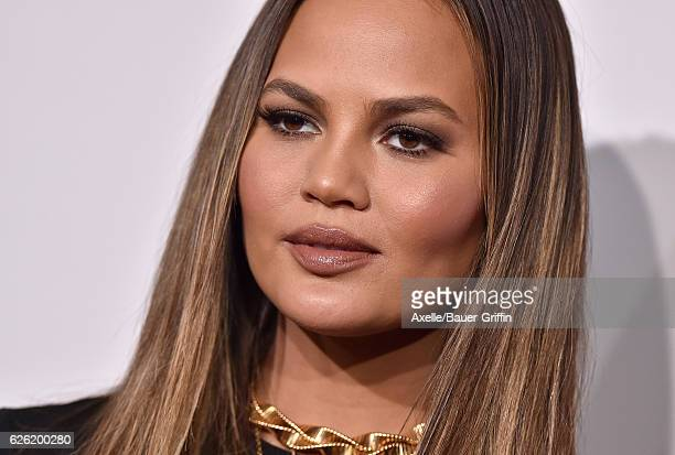Model Chrissy Teigen arrives at the 2016 American Music Awards at Microsoft Theater on November 20, 2016 in Los Angeles, California.