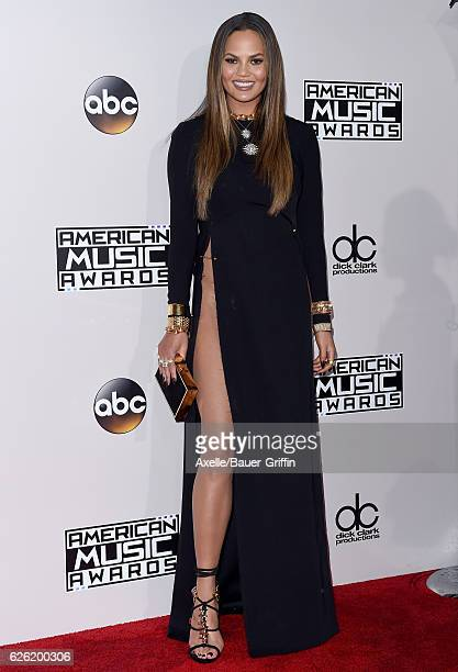 Model Chrissy Teigen arrives at the 2016 American Music Awards at Microsoft Theater on November 20 2016 in Los Angeles California
