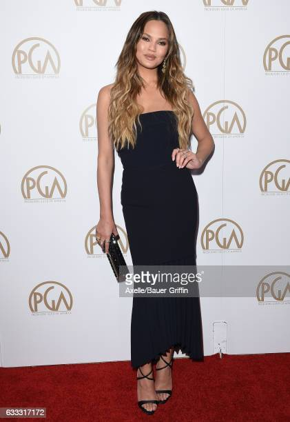 Model Chrissy Teigen arrives at the 28th Annual Producers Guild Awards at The Beverly Hilton Hotel on January 28 2017 in Beverly Hills California