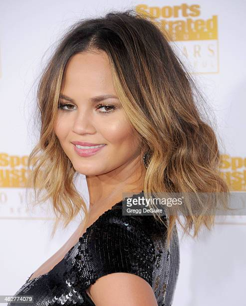 Model Chrissy Teigen arrives at the 50th Anniversary Celebration Of Sports Illustrated Swimsuit Issue at Dolby Theatre on January 14 2014 in...