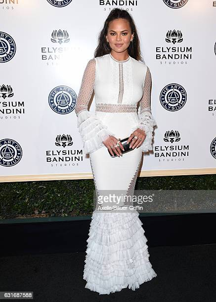 Model Chrissy Teigen arrives at The Art of Elysium celebrating the 10th Anniversary at Red Studios on January 7 2017 in Los Angeles California