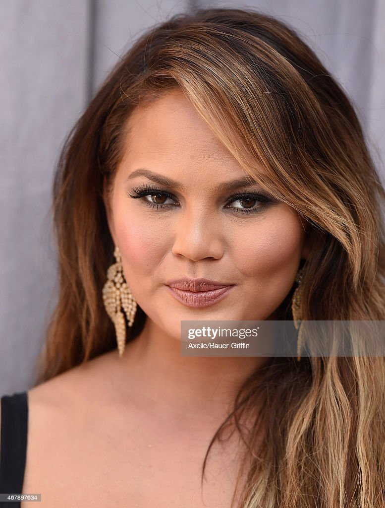 Model Chrissy Teigen arrives at the Comedy Central Roast of Justin Bieber on March 14, 2015 in Los Angeles, California.