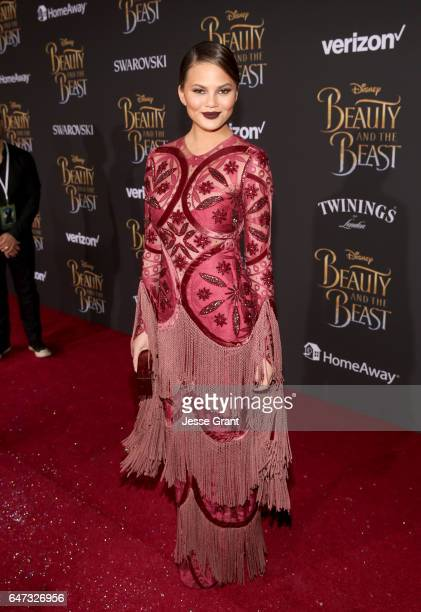 Model Chrissy Teigen arrives for the world premiere of Disney's liveaction 'Beauty and the Beast' at the El Capitan Theatre in Hollywood as the cast...