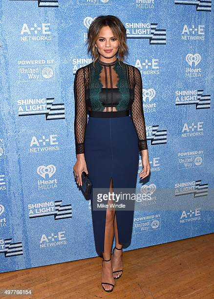Model Chrissy Teigen attends AE Networks 'Shining A Light' concert at The Shrine Auditorium on November 18 2015 in Los Angeles California