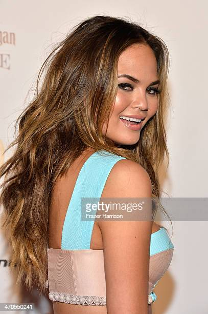 Model Chrissy Teigen attends Club SI Swimsuit at LIV Nightclub hosted by Sports Illustrated at Fontainebleau Miami on February 19 2014 in Miami Beach...