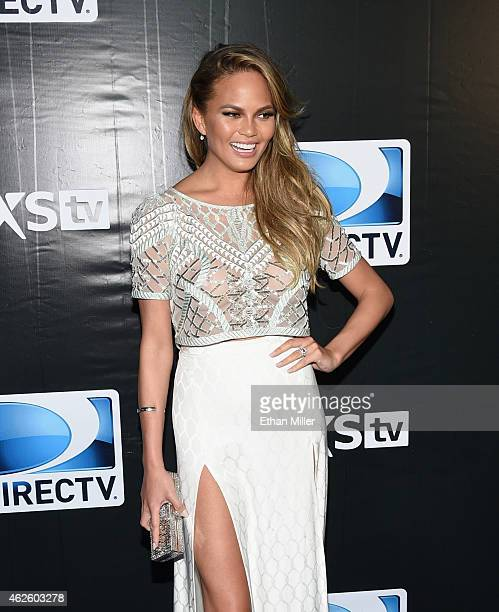 Model Chrissy Teigen attends DirecTV Super Saturday Night hosted by Mark Cuban's AXS TV and Pro Football Hall of Famer Michael Strahan at Pendergast...