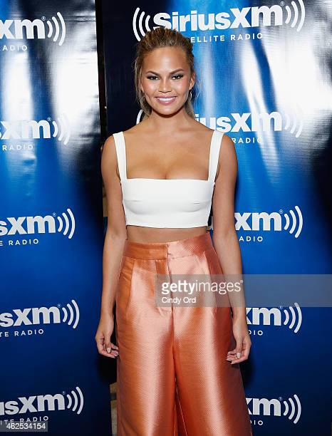 Model Chrissy Teigen attends SiriusXM at Super Bowl XLIX Radio Row at the Phoenix Convention Center on January 30 2015 in Phoenix Arizona