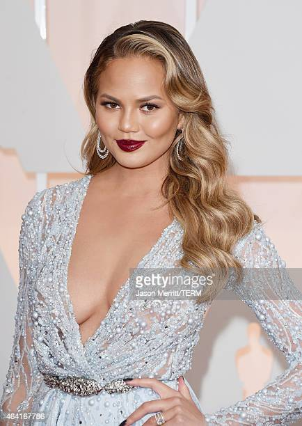 Model Chrissy Teigen attends the 87th Annual Academy Awards at Hollywood Highland Center on February 22 2015 in Hollywood California